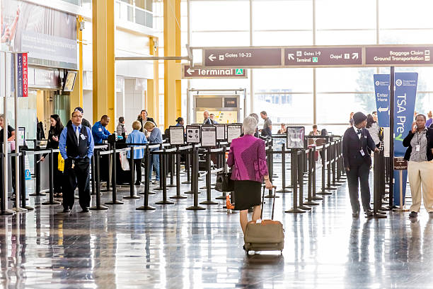Passengers in the TSA line in an airport stock photo