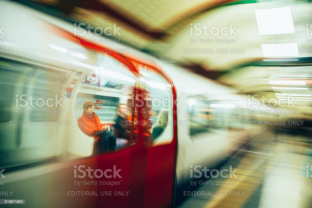 Passengers inside a London underground train. stock photo