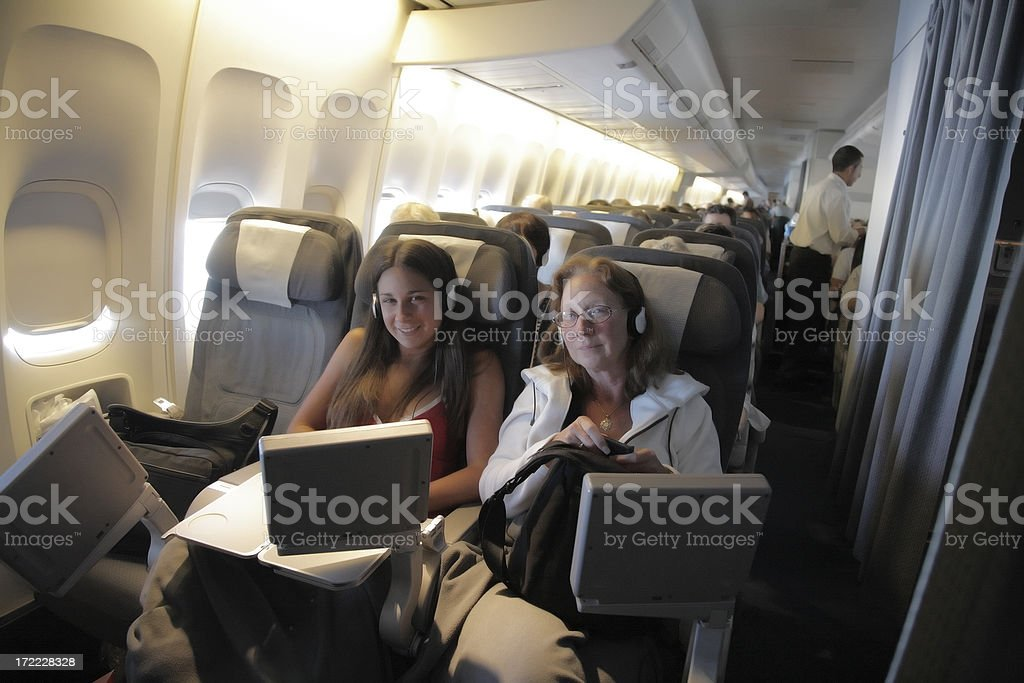 Passengers inside an airplane. stock photo