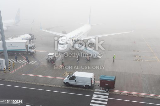 Boryspil International Airport is captured on a foggy autumn day. Boryspil International Airport is the largest and the busiest airport in Ukraine. It provides over 67% of the passenger air traffic of Ukraine, handling over 10 million passengers per year. Boryspil is well-located at the intersection of numerous air-routes, connecting Asia with Europe and America.