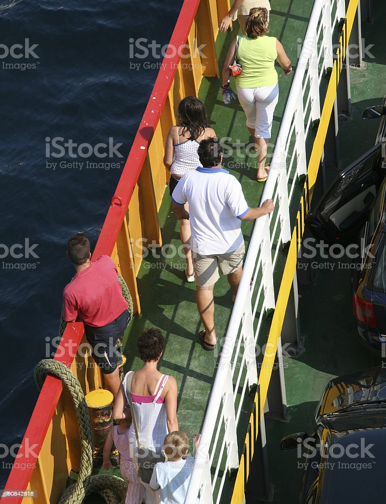 Passengers leaving ferry in habour of  island Thassos,  Greece royalty-free stock photo