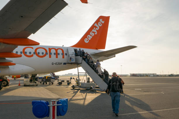 Passengers of EasyJet airline boarding to the plane stock photo