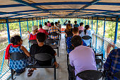 Kerala, India - March 31, 2018: Passengers on a boat traveling on a backwaters canal. Taken on a sunny spring day with 18 passengers