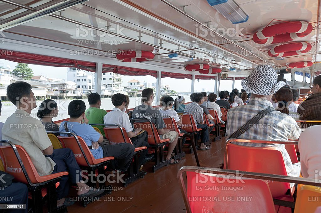 Passengers On A Ferry In The Chao Phraya River, Bangkok royalty-free stock photo