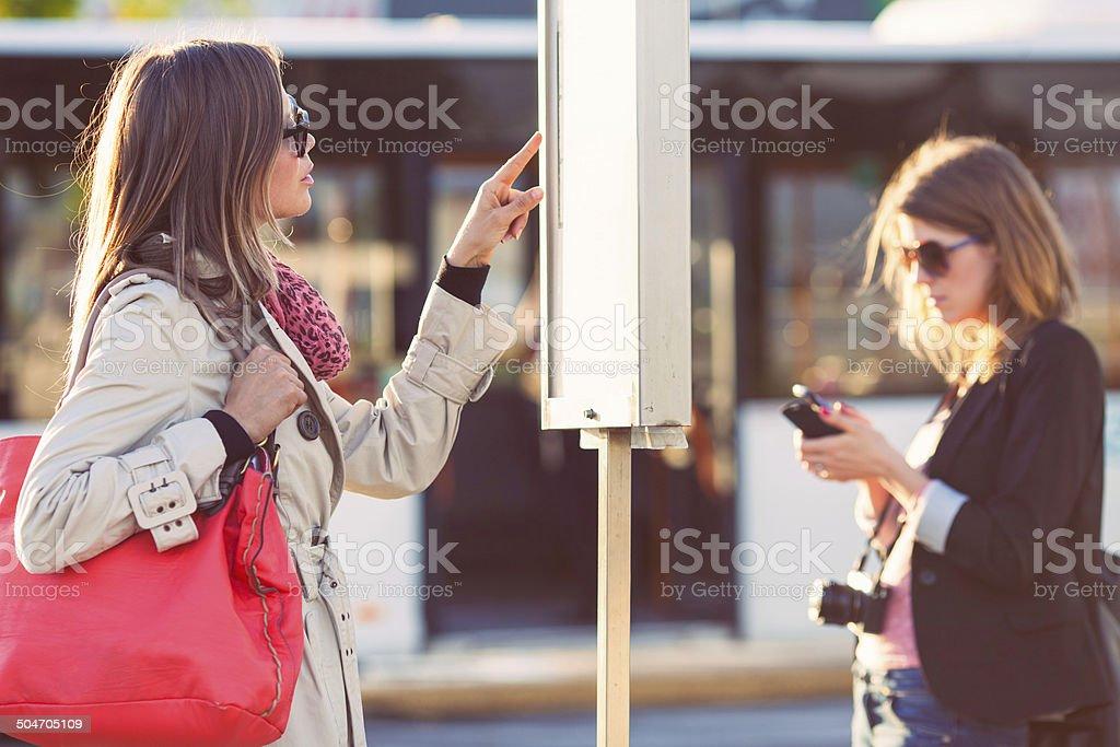 Passengers on bus station stock photo
