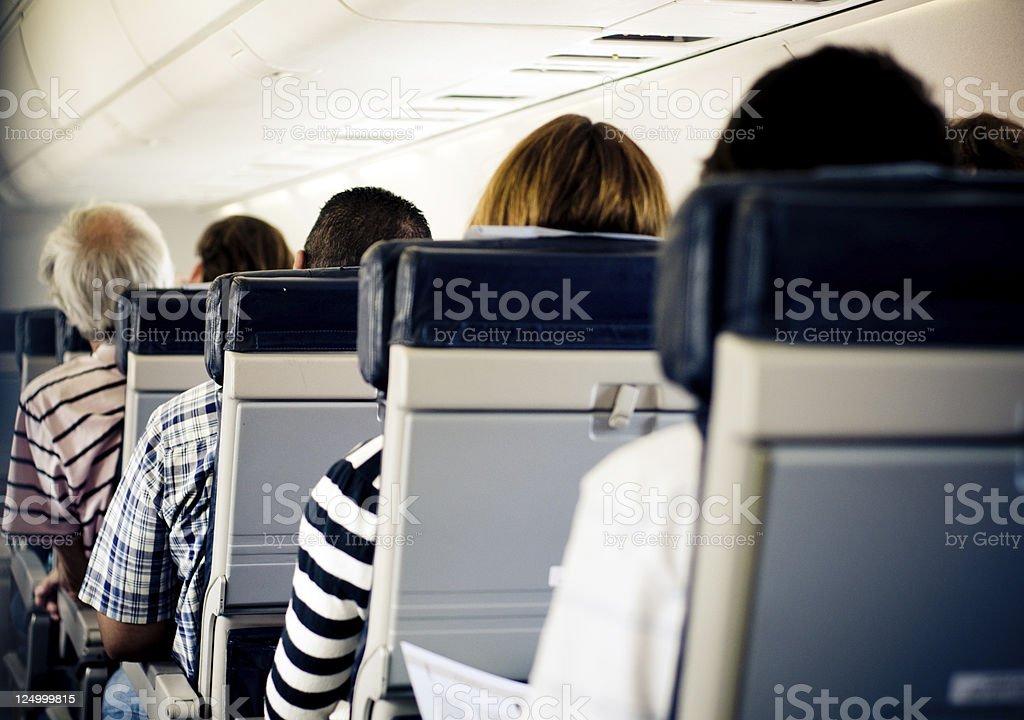 Passengers on plane royalty-free stock photo