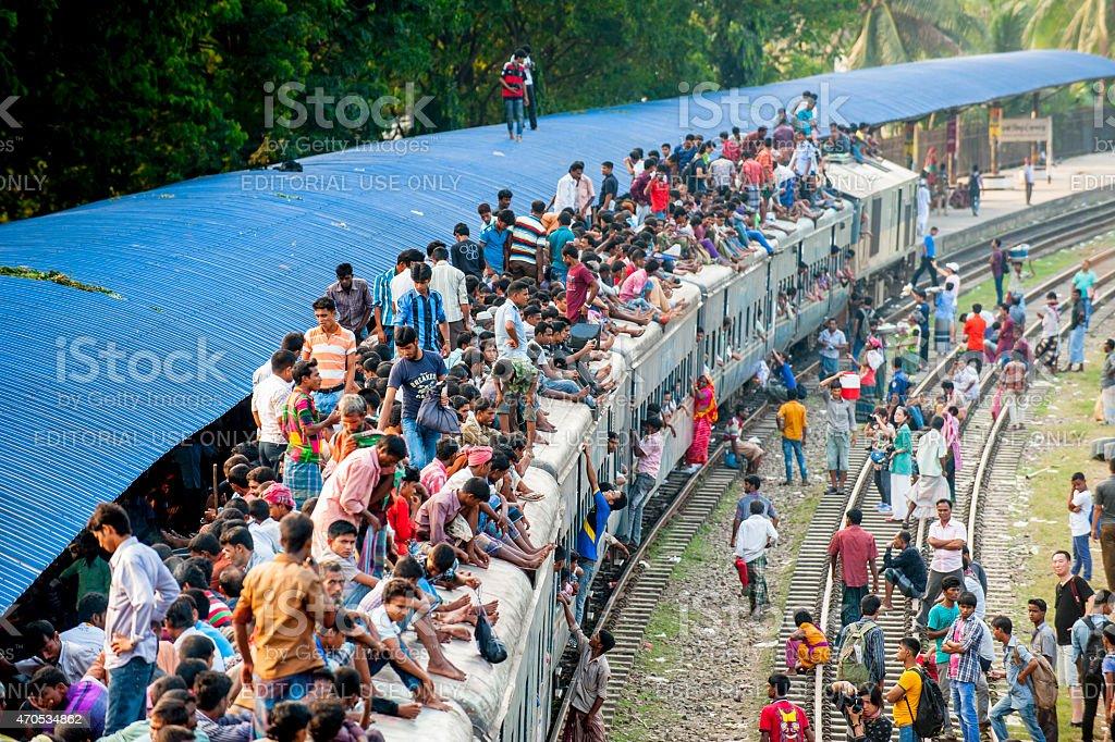 Passengers on the roof of train, Dhaka, Bangladesh stock photo