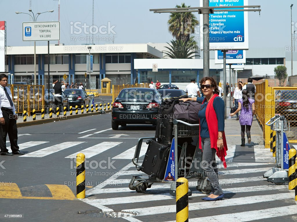 Passengers outside Lima Airport arrivals hall royalty-free stock photo