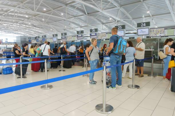 Passengers pass passport control in Larnaca International Airport – zdjęcie