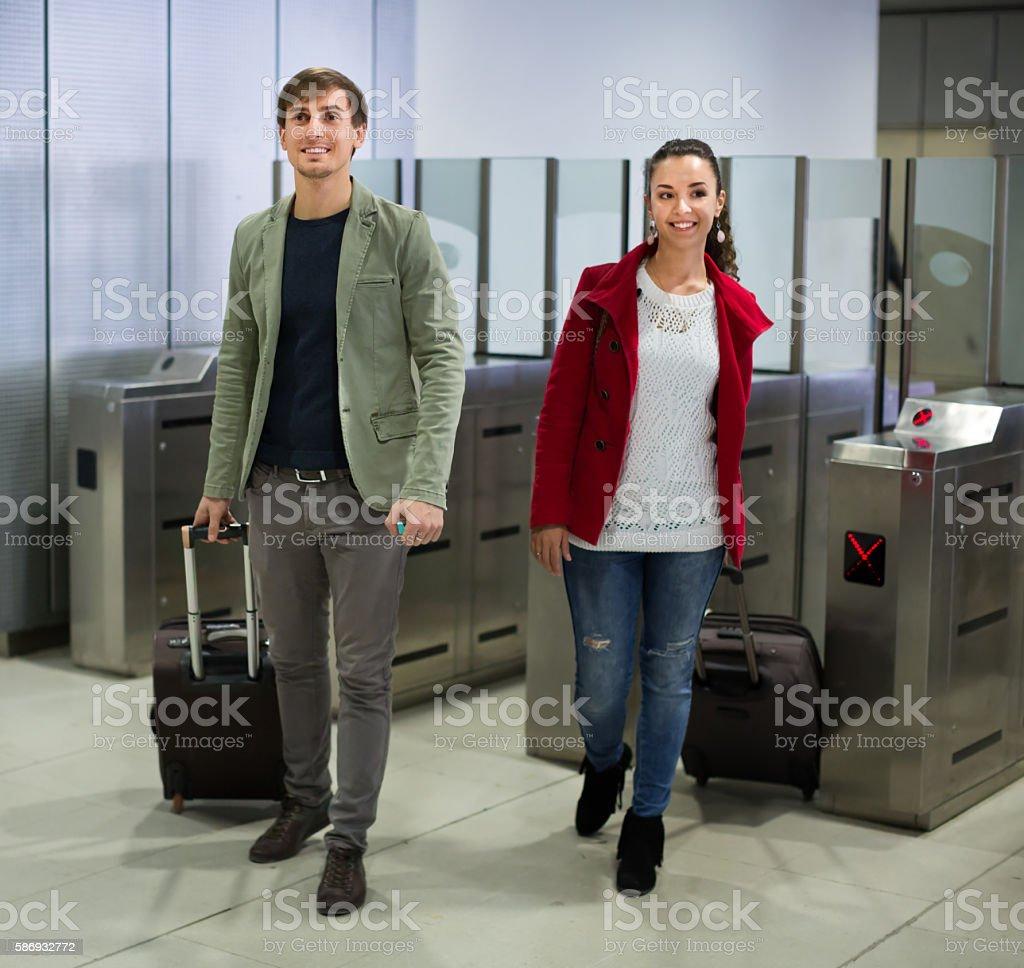 Passengers passing the turnstile stock photo