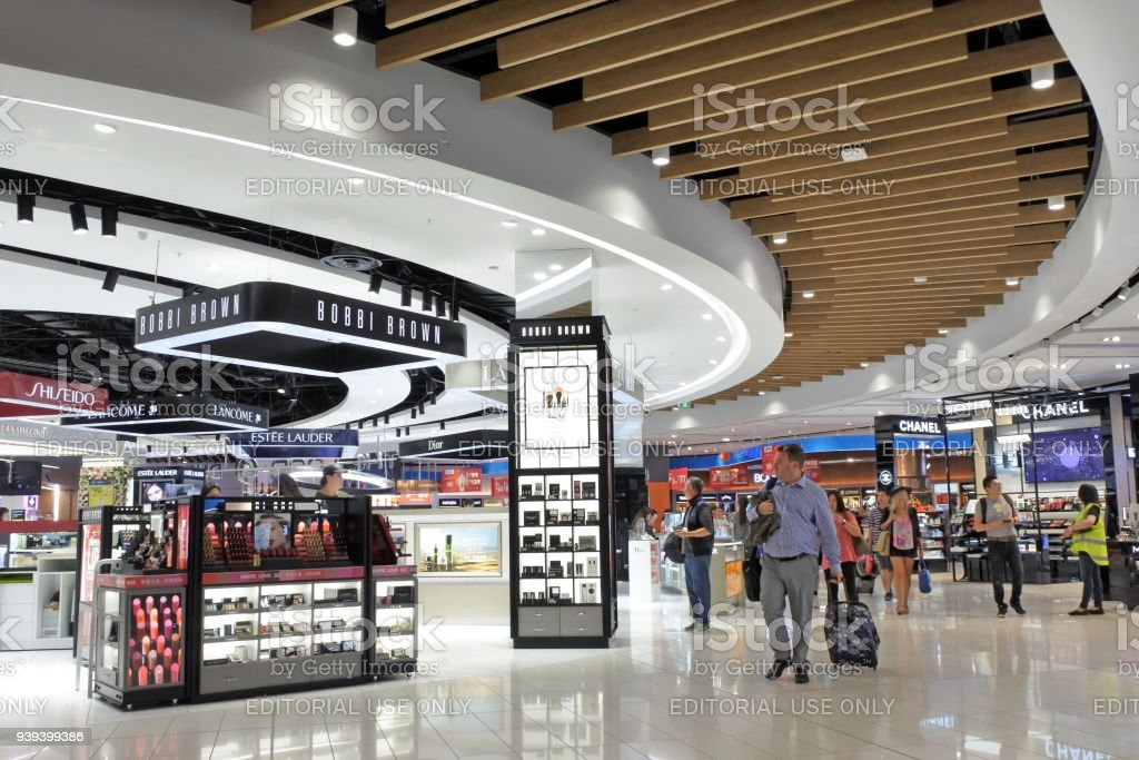 Passengers passing through the new Auckland airport International departure duty free area stock photo