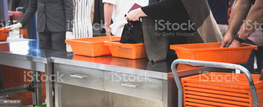 Passengers queue on the line for scanning bags stock photo