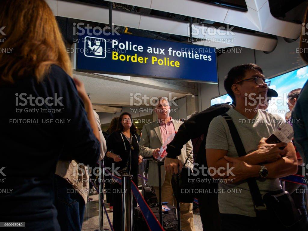 Passengers queue up at border control, Paris, France stock photo
