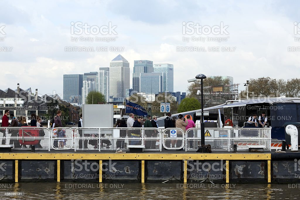 Passengers queuing to board a Thames Clipper royalty-free stock photo