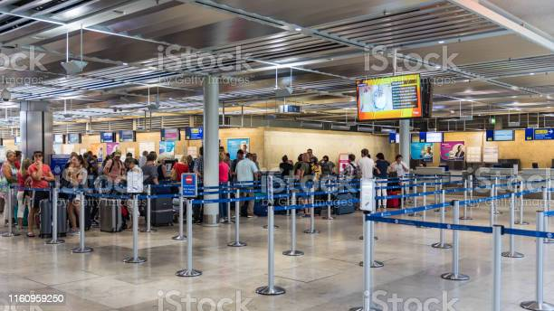 Passengers queuing up in checkin counter in the nuremberg airport of picture id1160959250?b=1&k=6&m=1160959250&s=612x612&h=shw8ygtdcfmoop3e305le0suos3ffuonjj076pwlsxk=