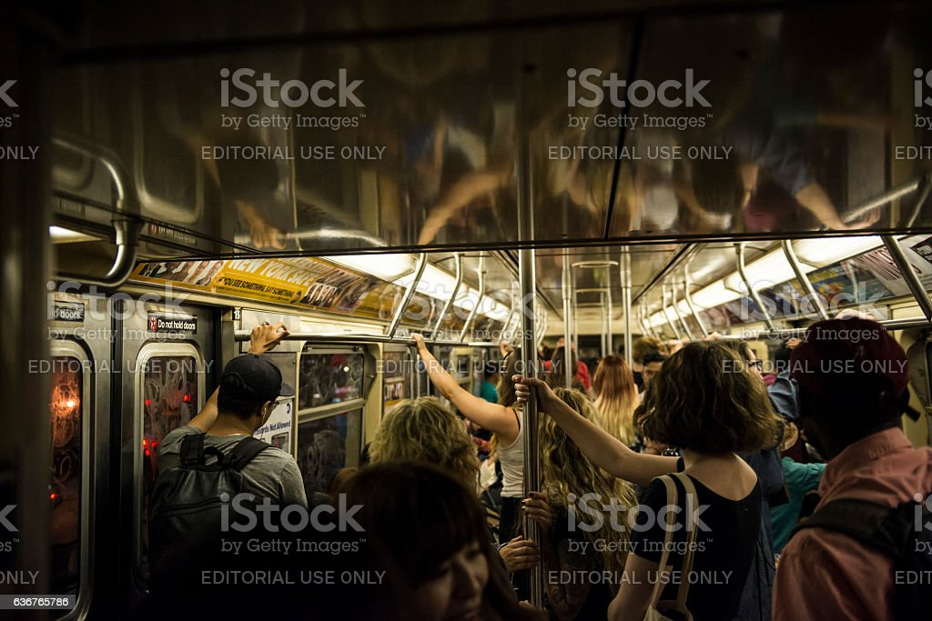 Passengers riding New York City subway stock photo