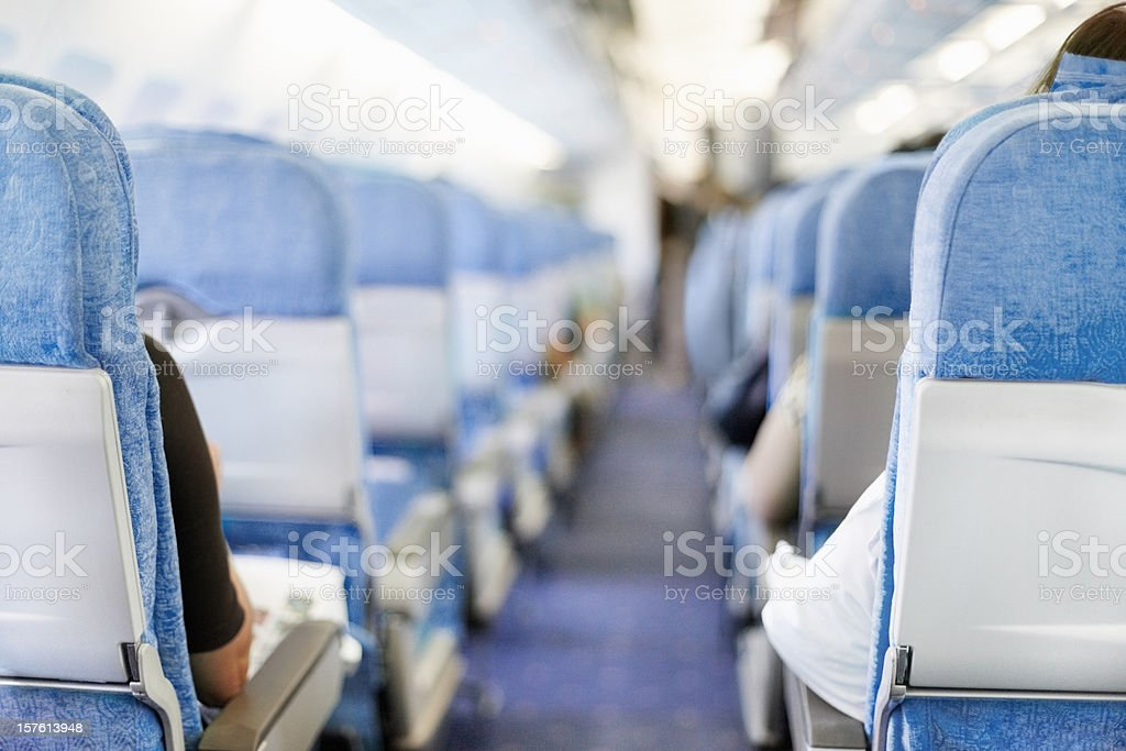 Passengers seated in an airplane stock photo