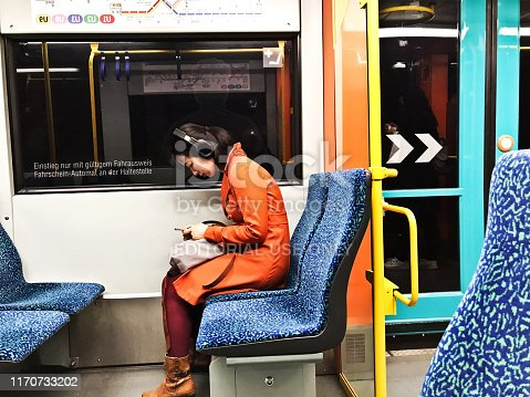 istock Passengers (incl. a Chinese tourist) sitting in a colourful U-Bahn train departing from Frankfurt am Main Hauptbahnhof (Frankfurt central station) - Germany 1170733202