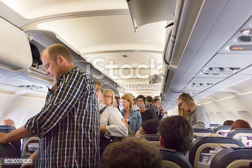 Thessaloniky: Passengers standing, waiting to disembark in the economy class of an Airbus 320 on the route Thessaloniky - Munich of Eurowings Airline.