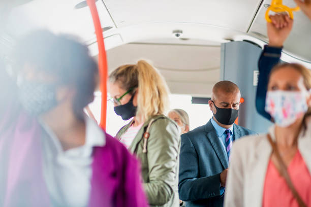Passengers staying Protected During Rush Hour stock photo