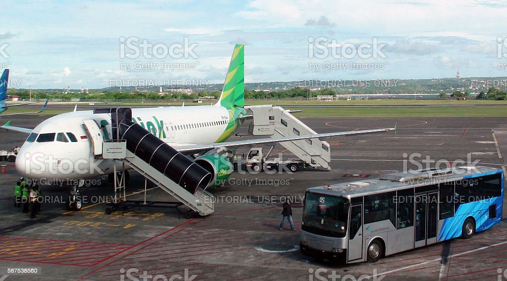 Passengers Stepping Out From Citilink Airline After Arrival At Bali.Airport.Indonesia stock photo