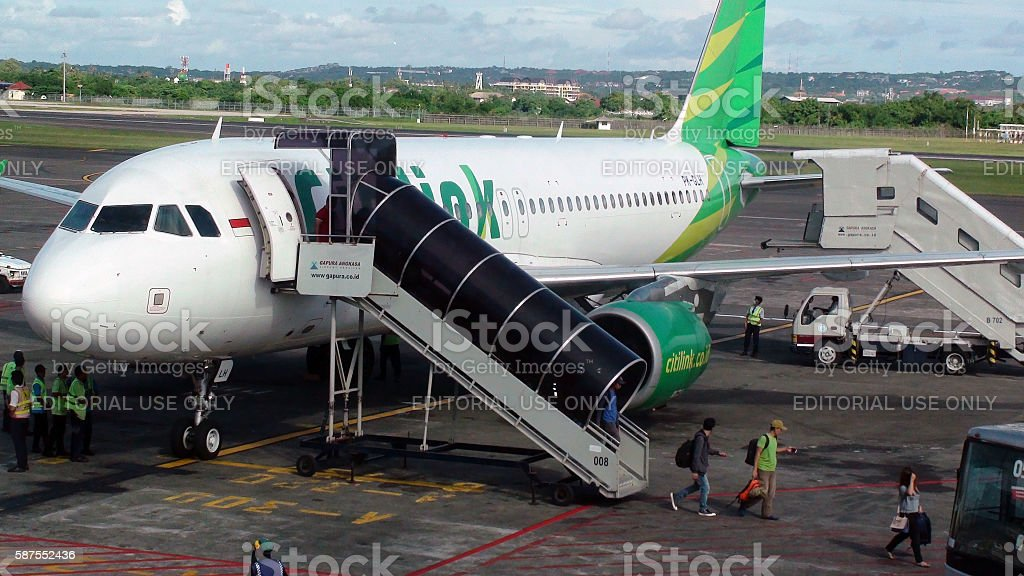 Passengers Stepping Out From Citilink Airline After Arrival At Bali.Airport.Indonesia.Asia stock photo