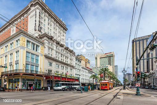 NEW ORLEANS - JULY 16, 2013: people travel with the old Street car Canal street line St. Charles line in New Orleans, USA.  It is the oldest continually operating street car line in the world.