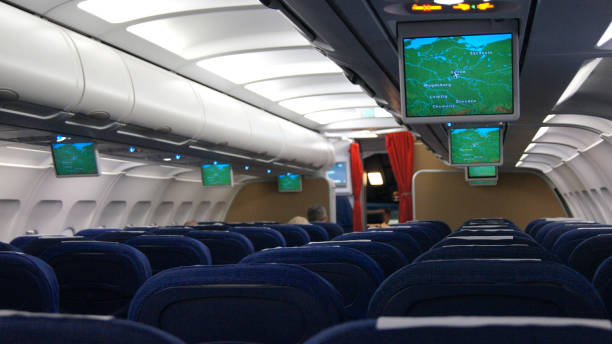 Passengers traveling by a plane, shot from the inside of an airplane in the cabin stock photo