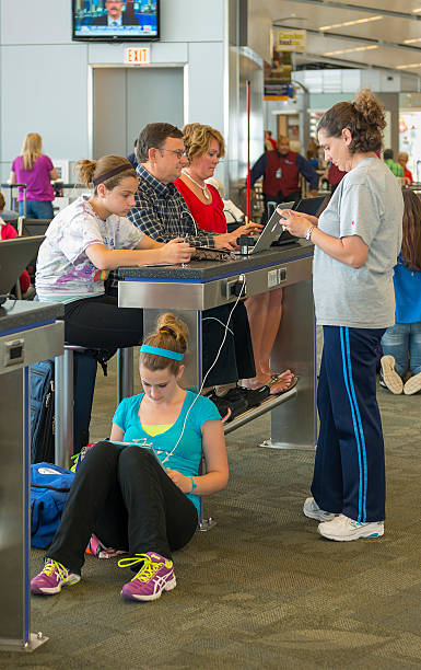 Passengers using charging station in Indianapolis airport stock photo