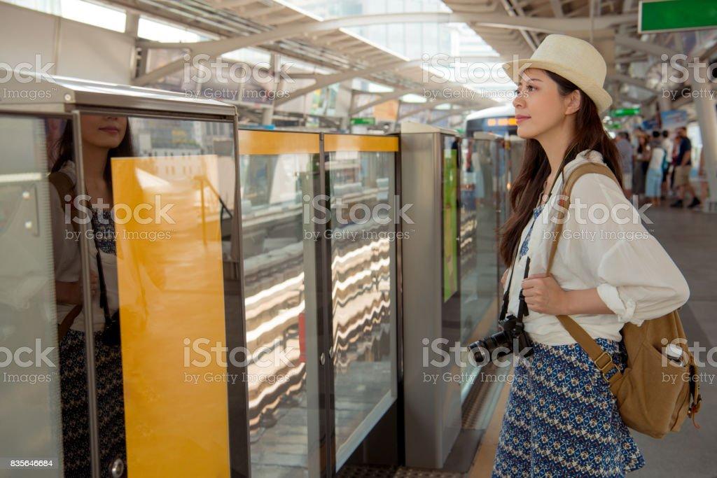 Passengers wait on a platform as a BTS stock photo