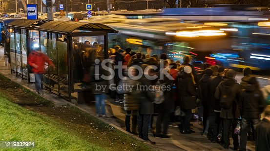 1060957508 istock photo Passengers waiting and boarding buses at the bus terminal 1219832924