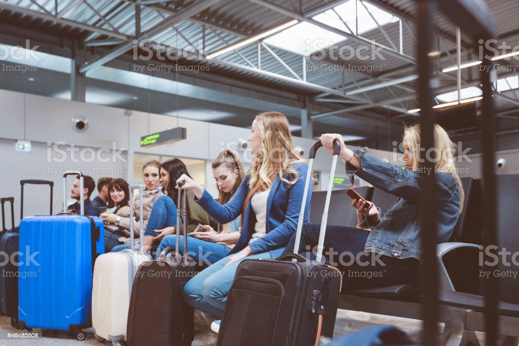 Passengers waiting at airport lounge stock photo