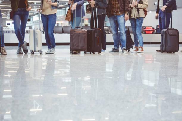 Passengers waiting at boarding gate at airport stock photo