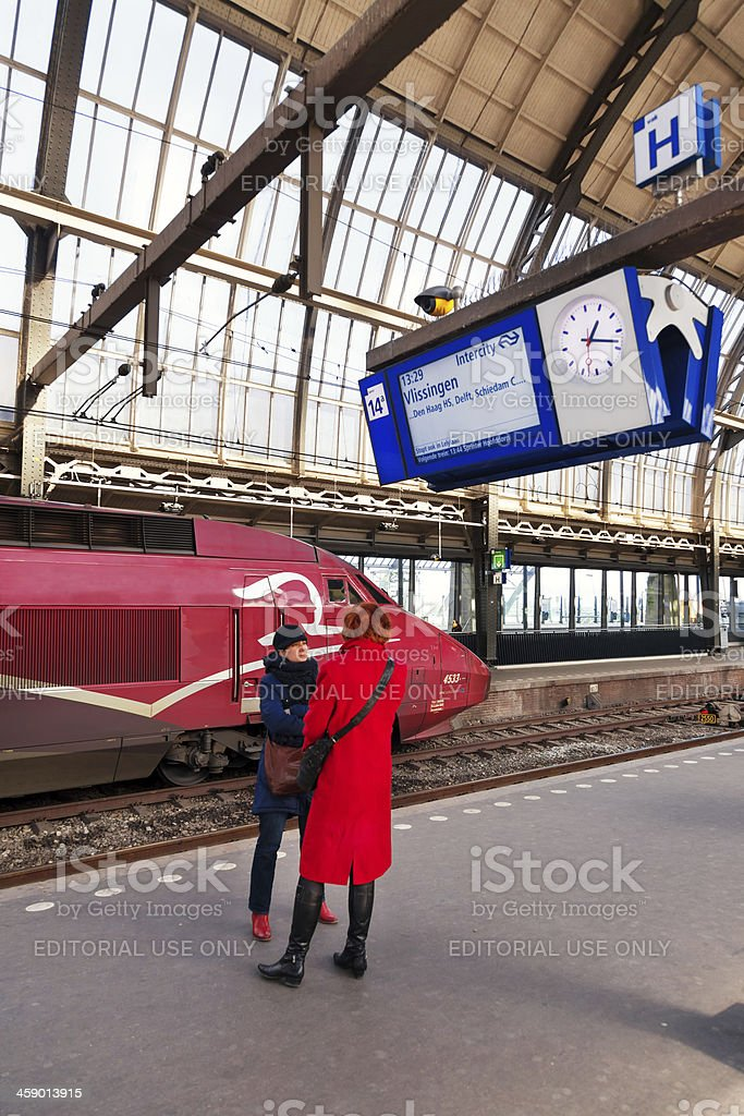 Passengers waiting for the train in Amsterdam Central Station royalty-free stock photo