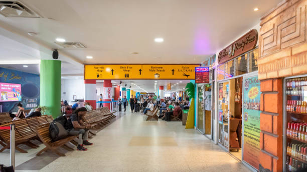 Passengers waiting for their flights inside Philip S W Goldson Airport in Belize, Central America.