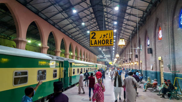 Passengers waiting for their train at Lahore Station Passengers waiting for their train at Lahore Station, Pakistan At Night 03/05/2019 lahore pakistan stock pictures, royalty-free photos & images
