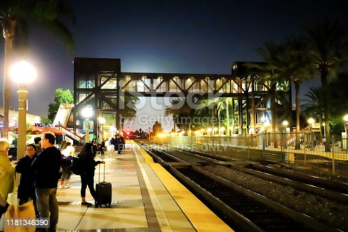 Fullerton, CA, USA - Oct.13.2019: Passengers waiting for train at Fullerton Station.  Fullerton Station located at Fullerton, CA. This station serves by Amtrak and Metrolink train services.  Passengers are waiting for the trains on the platform.