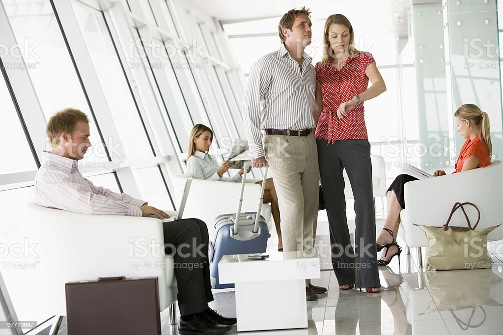 Passengers waiting in airport lounge stock photo