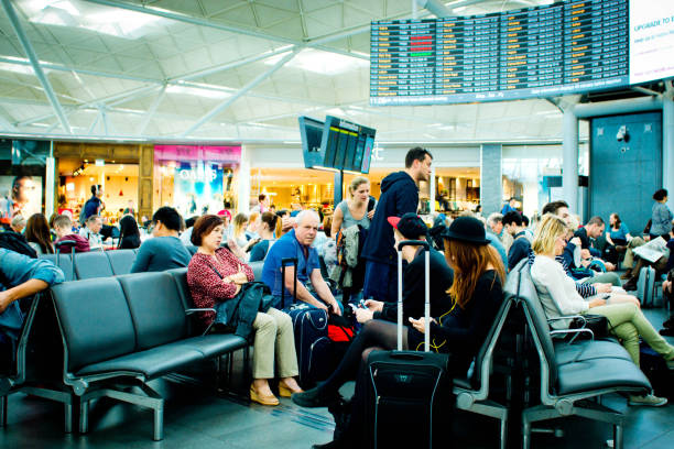 Passengers waiting in departures stock photo