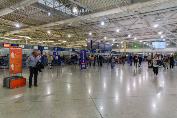 Passengers waiting in line at service counters prior to departure in Athens International Airport Eleftherios Venizelos. stock photo