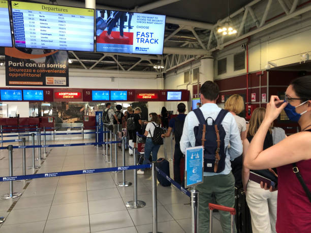 Passengers waiting in line at the Ciampino airport outside Rome, Italy stock photo