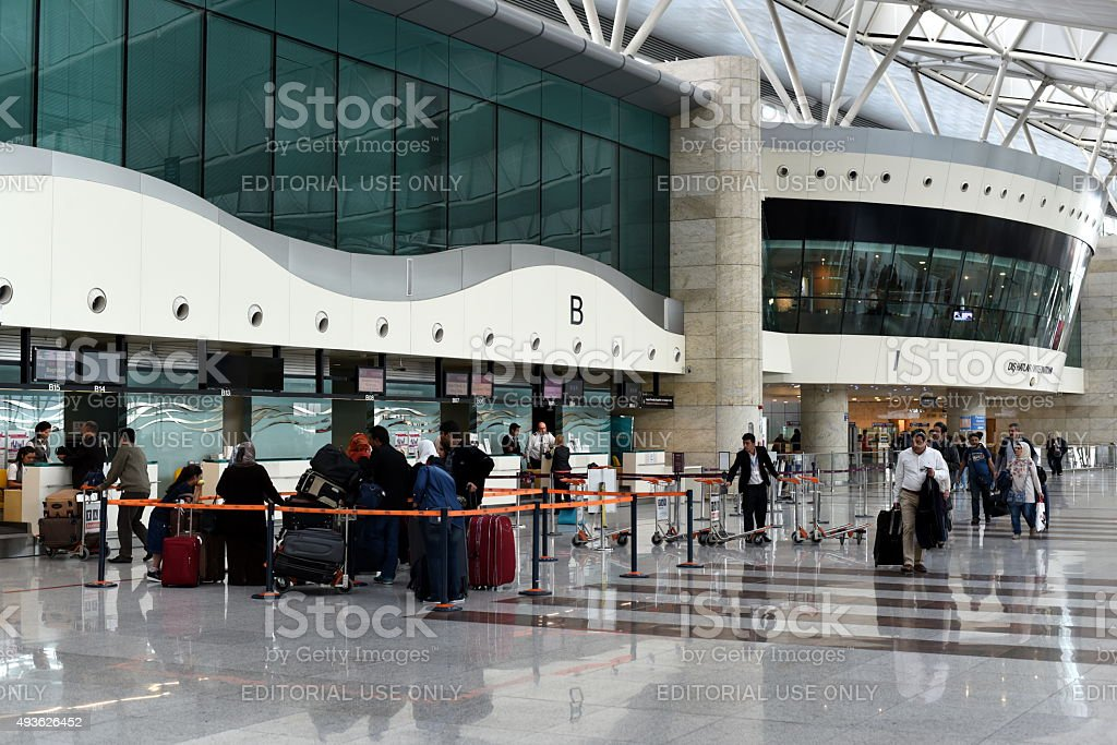 Passengers waiting in the queue and walking in terminal stock photo