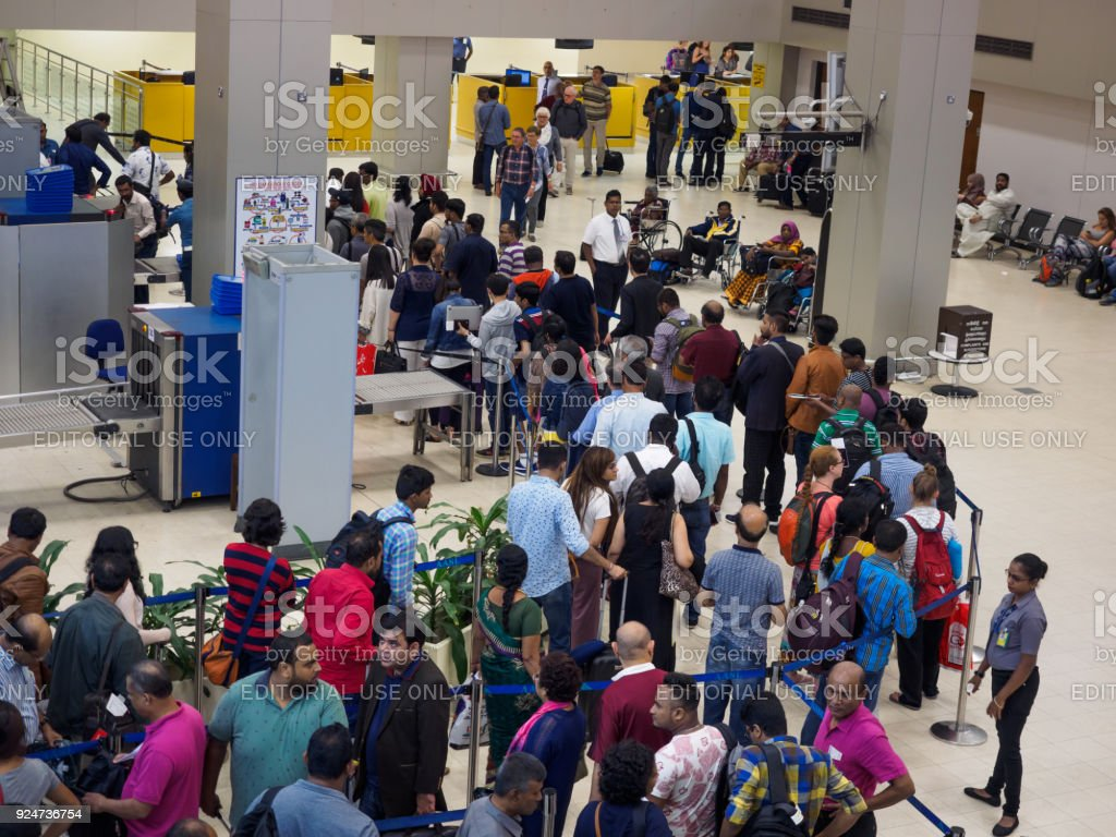 Passengers waiting  in the queue for security check at Sri Lanka Bandaranaike International Airport stock photo