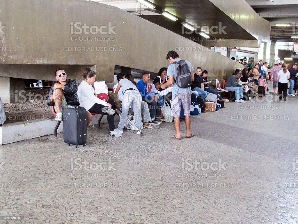 Passengers waiting outside a Brazilian coach station stock photo