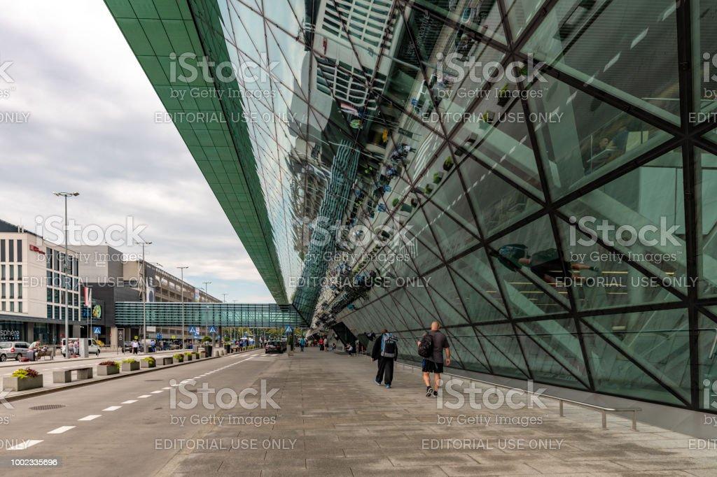 Passengers walk to Kraków John Paul II International Airport in Poland stock photo