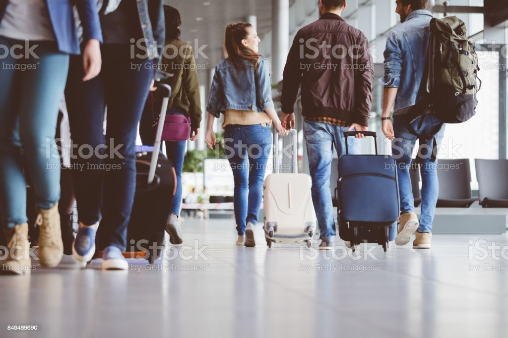 Passengers walking in the airport corridor stock photo