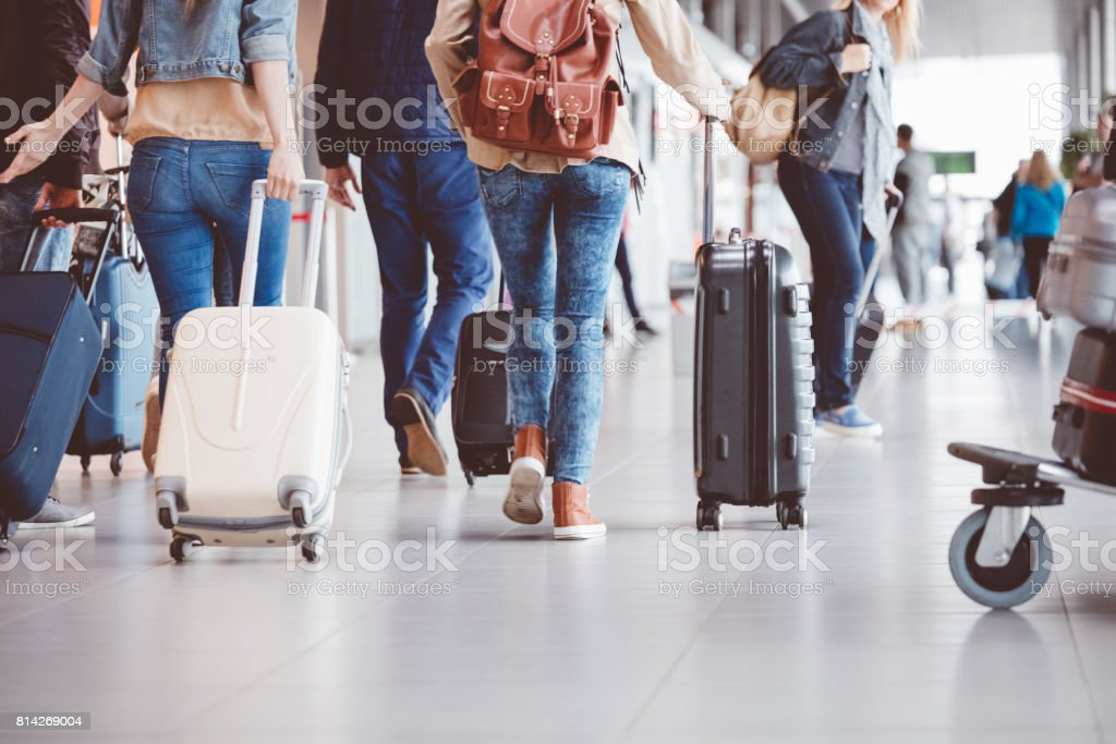 Passengers walking in the airport terminal stock photo