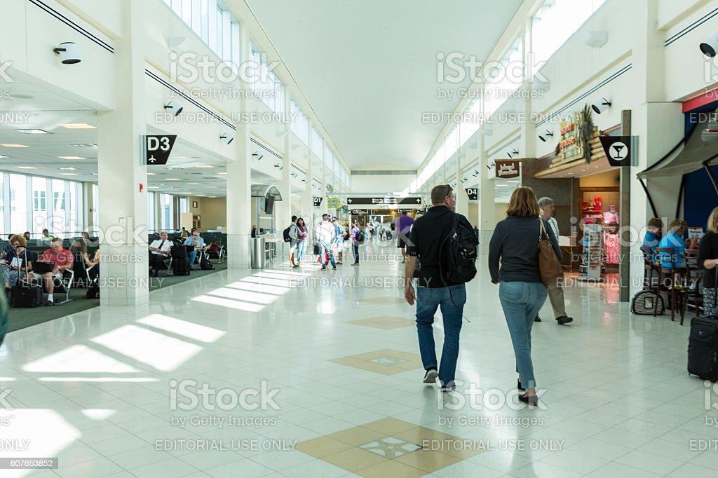 Passengers Walking Through Airport Terminal In Ft. Myers Florida stock photo