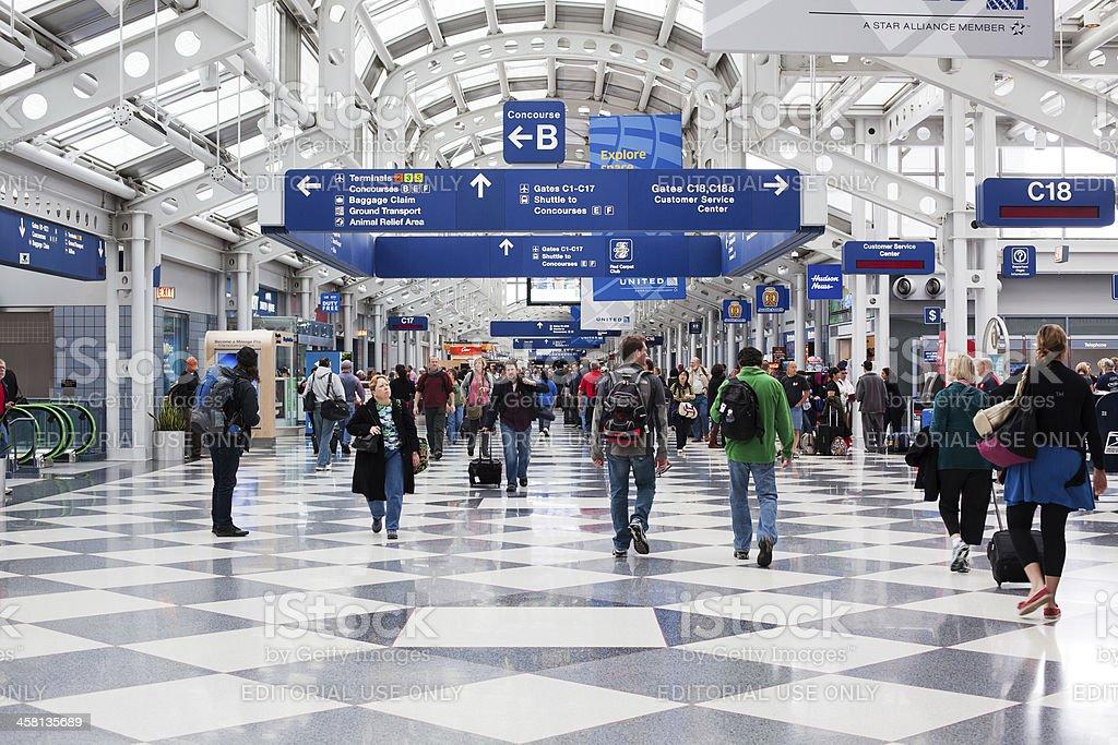 Passengers walking through Chicago O'Hare International Airport royalty-free stock photo