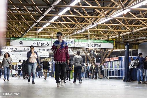 Sao Paulo, Brazil, July 27, 2019 - Passengers walking to the Metro (Subway) and Train (CPTM) entrance in Tatuapé Metro / Train Station